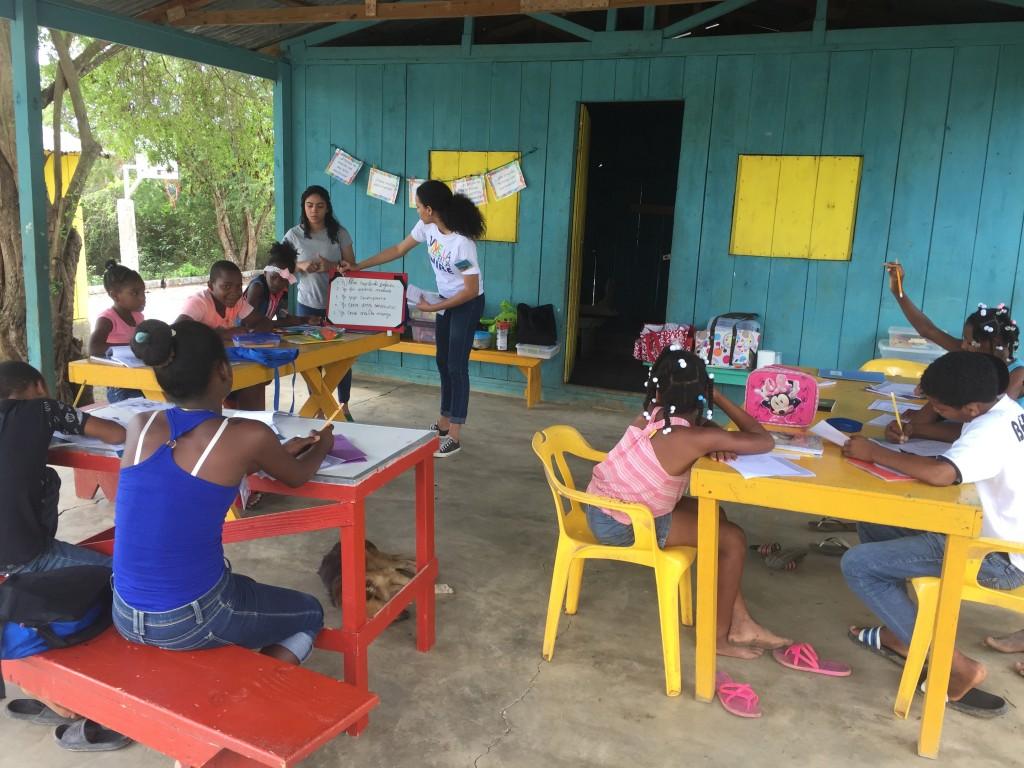 Volunteers teaching 5 Star Writing.